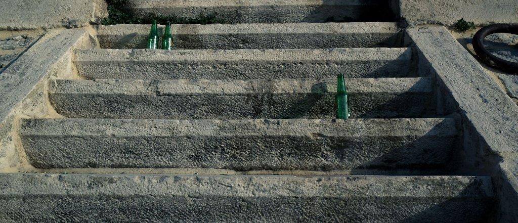 Empty beer bottles on steps, Arles