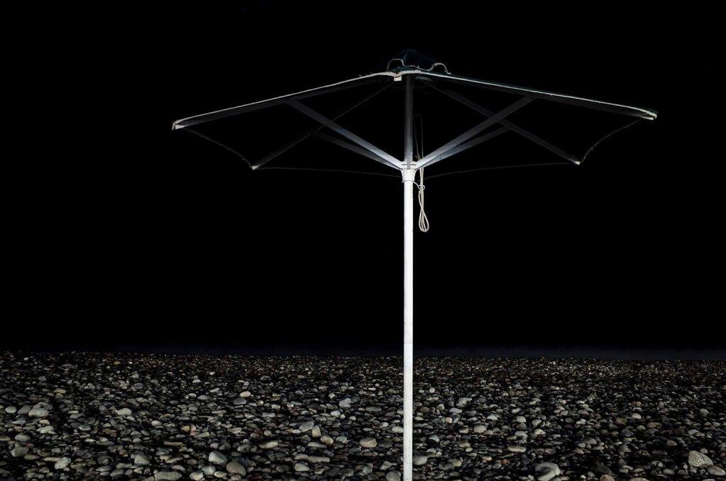 Beach umbrella at night